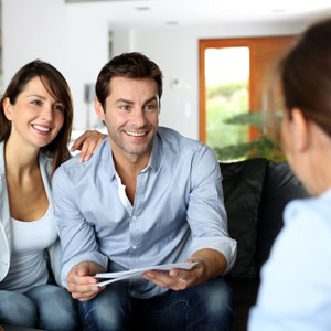 couple meeting with financial counselor